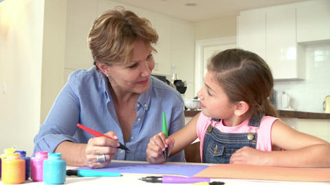 Grandmother Drawing Picture With Granddaughter At Home Footage