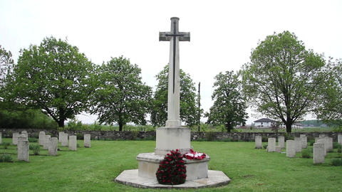 In the cemetery of heroes, a large cross as a monument. Near the cross, is a cro Live Action