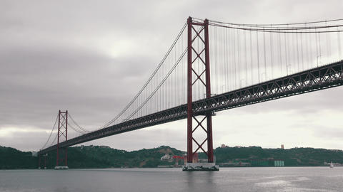 25 de Abril Bridge in Lisbon, cloudscape Footage