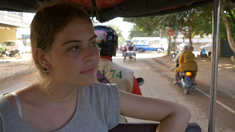 Backpacker tourist girl traveling in asia riding on tuk tuk rural asain villag Footage
