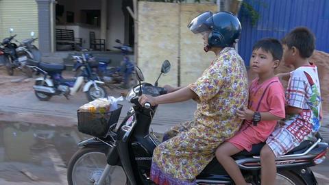 SIEM REAP, CAMBODIA - NOV 2015: Young boy on bike Footage