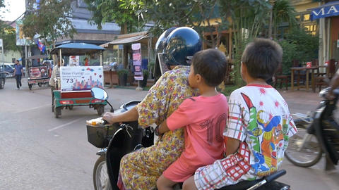 SIEM REAP, CAMBODIA - NOV 2015: Asian family riding on motor bike Footage