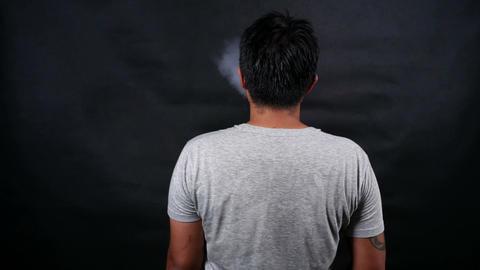 Man vaping electronic cigarette makes smoke clouds, guy smoking e-cig Live Action