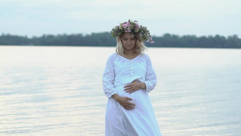 Young Beautiful Woman With Flower Wreath At The River. A... Stock Video Footage