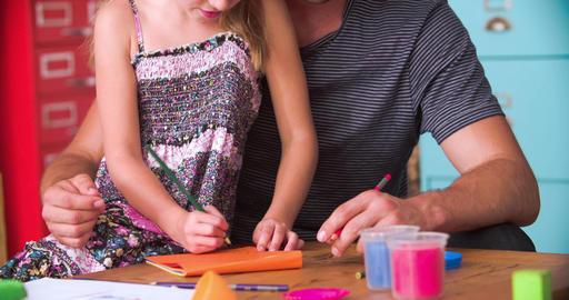 Father And Daughter Coloring Picture In Child's Bedroom Footage