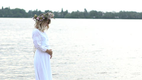 Beautiful Pregnant Young Girl With A Wreath On His Head Stay Near River Slow 画像