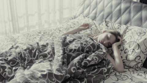 Young Woman Sleeping In Bed Having Nightmares And Moving Slow Motion Footage