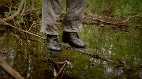Hanged man over the swamp camera move around 画像