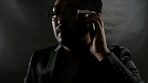 close up Serious Businessman in Black Suit talking on cellphone Footage