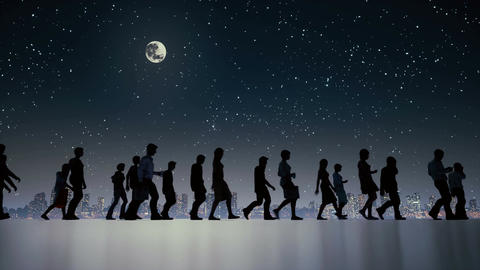 Anonymous business people crowd walking in night city Image