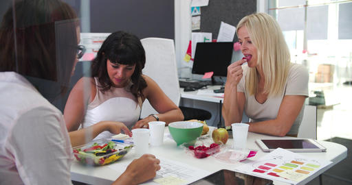 Three Businesswomen Having Working Lunch In Office Stock Video Footage