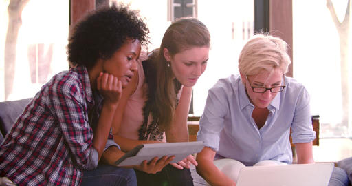 Three Businesswomen Having Informal Meeting In Office Live Action