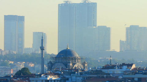 Mosque in Istanbul with skyscrapers in the background Archivo