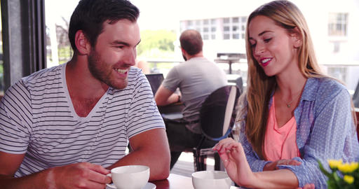 Woman Joins Man Sitting At Table In Coffee Shop Footage