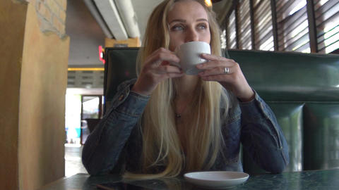 Young Attractive Woman Drinking Coffee In Cafe, Steadicam Shot Slow Motion Footage