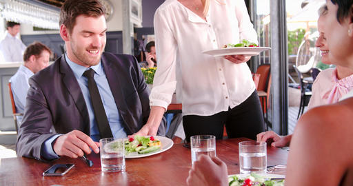 Three Businesspeople Having Working Lunch In Restaurant Live Action