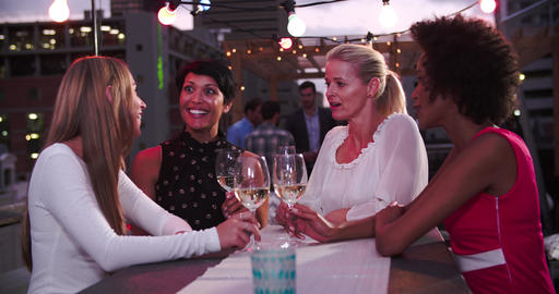 Group Of Female Friends Relaxing Together At Rooftop Bar Footage