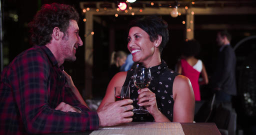 Mature Couple Relaxing Together At Rooftop Bar Live Action