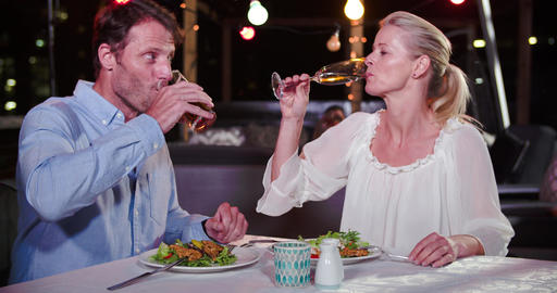 Mature Couple Enjoying Meal At Rooftop Restaurant Live Action