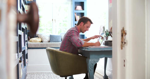 View Through Door Showing Man Working In Home Office Live Action