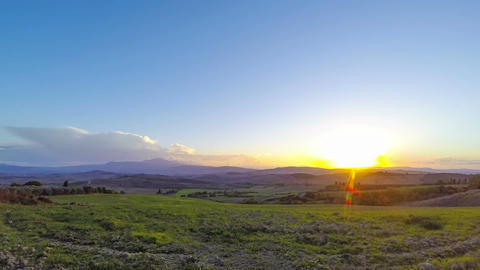 Sunset over the Tuscany Fields. Time Lapse Footage