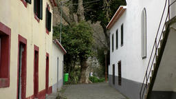 Portugal Madeira camera zooms out of an inner courtyard in Monte village Footage