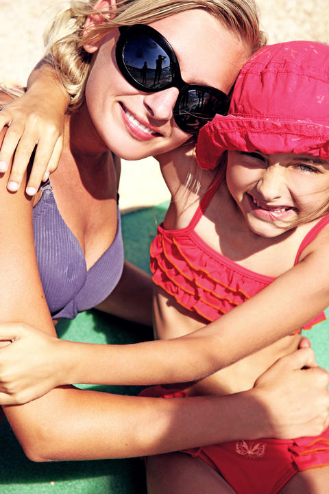 Mother and daughter on a beach フォト