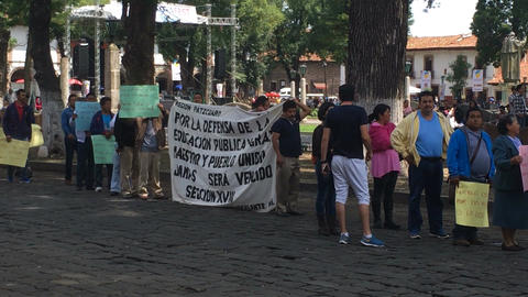 PATZCUARO , MEXICO - CIRCA JULY 2016 - Teachers protesting peacefully with signs Footage
