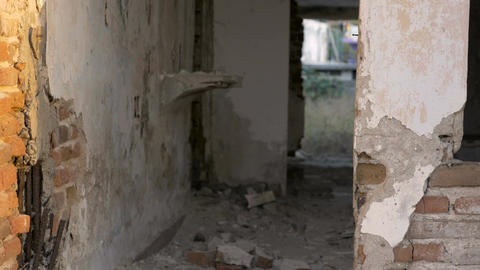 A destroyed hotel room with crumbling walls, brick, and floors from a major eart Footage