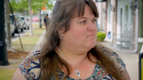 Extremely frustrated irritated overweight beautiful woman expressing emotions ou Footage