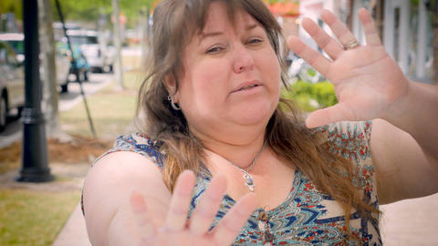 A frightened scared heavy woman showing fear and raising... Stock Video Footage