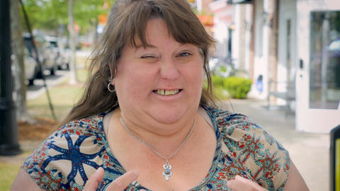 Disgusted grossed out bothered overweight woman expressing emotions on city side Live Action