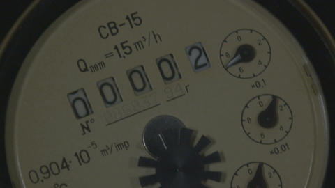 Macro Camera Moves across Old Cold Water Meter Device Footage