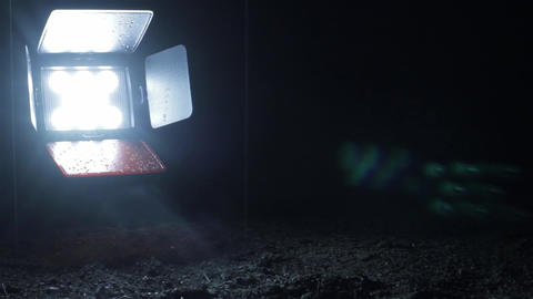 Raindrops seen in the spotlight sitting down in a dark and cold night 14 Footage
