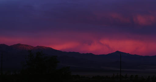 Setting Sun behind Mountain in Time Lapse Footage