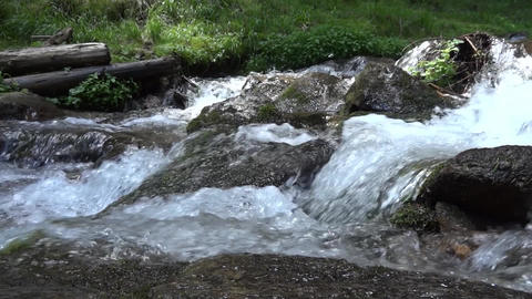 Spring up in the mountains, flowing over rocks. A source is groundwater or gushi Footage