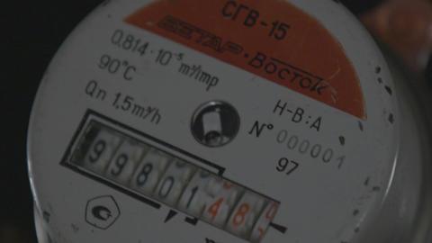 Macro Household Hot Water Meter in Dark Background Footage