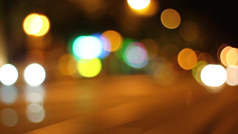 Defocused image of illuminated street light Live Action