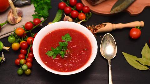 Cold soup of tomato gazpacho in a white plate Archivo