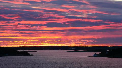 cruising through norwegian islets scenic shot at sunset Footage