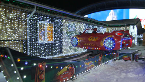 Extreme Luminous Car Attraction Located in Entertainment Park Footage