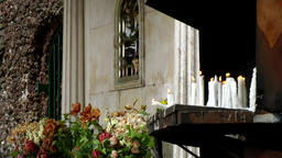 Portugal Madeira catholic prayer candles on altar in Monte village Image