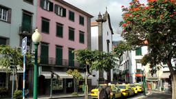Portugal Madeira taxi rank and colorful houses in Funchal old town Footage