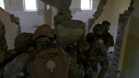 Teamwork of special military unit descending stairs during an armed operational  Footage