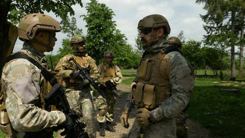 Closeup of platoon listening to orders from commander during briefing before mil Live Action