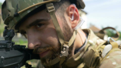 Closeup portrait of young army ranger aiming gun during a military training Footage