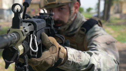Slow motion closeup of soldier and his military gun during special training exer Footage