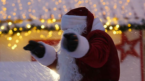 Santa Claus Dances against Bright Lights and Snow at Frost Footage