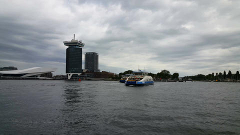 Pont sails back and forth over IJ river Amsterdam Footage