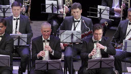 Musicians play on the wind instruments in the orchestra Footage